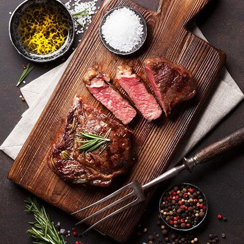 Ribeye steak cut and ready to served.